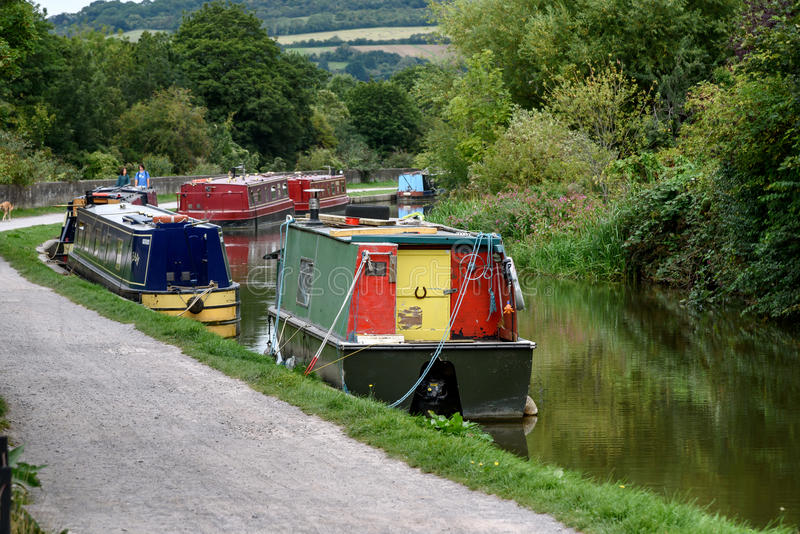 Barges on River Avon UK. Barges moored on river avon & kenet canal in Bath, Somerset, UK royalty free stock photography