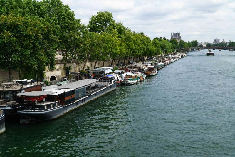Barges parked on the banks of the quays in Paris. Barges, on the Seine, parked on the banks of the quays in Paris royalty free stock images