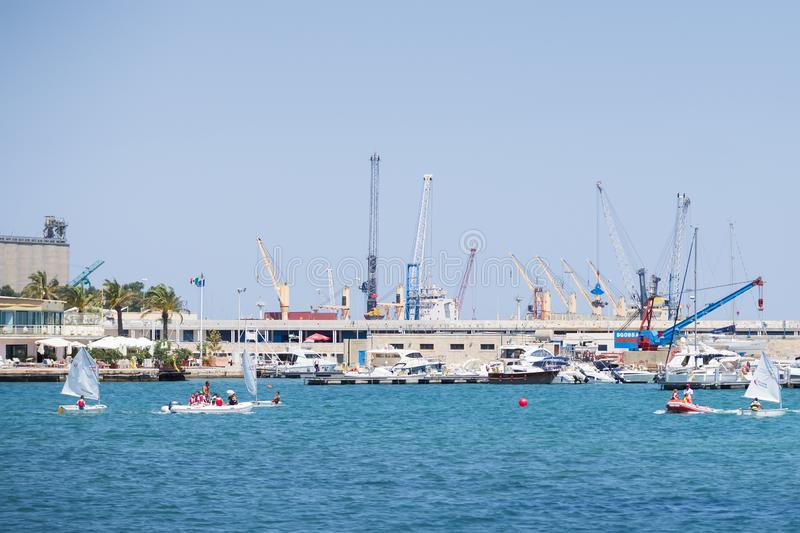 BARI, ITALY - JULY 11,2018, cranes and boats in the port of Bari, people boating, Apulia, Italy stock photo