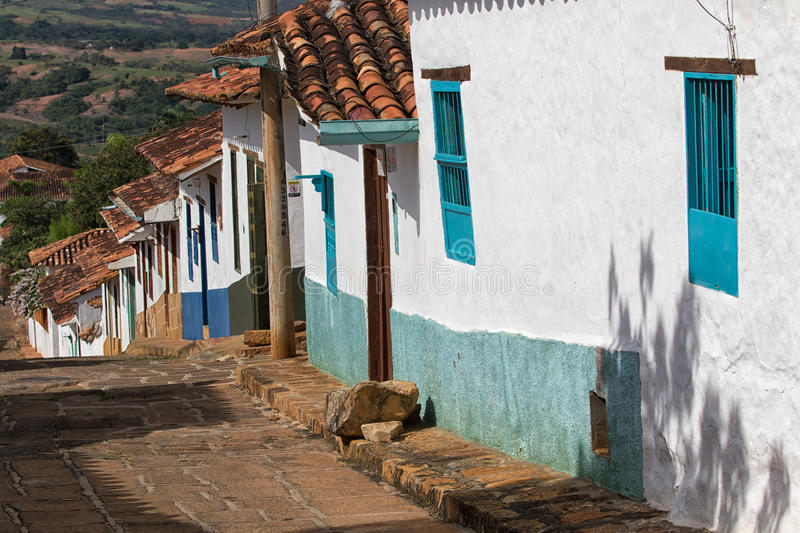 Barichara Colombia colonial houses. Whitewash colonial houses with colorful doors and windows stock photo