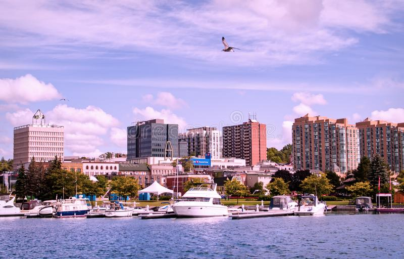 Barrie, Ontario, Canada - 2019 08 25: Lake Simcoe shore view with the Heritage Park on the right the city of Barrie. Ontario, Canada royalty free stock image
