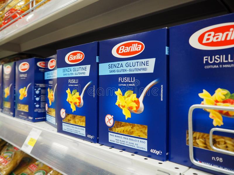 Barilla Fusilli Senza Glutine italian pasta that are formed into corkscrew or helical shapes on the supermarket shelves. stock images