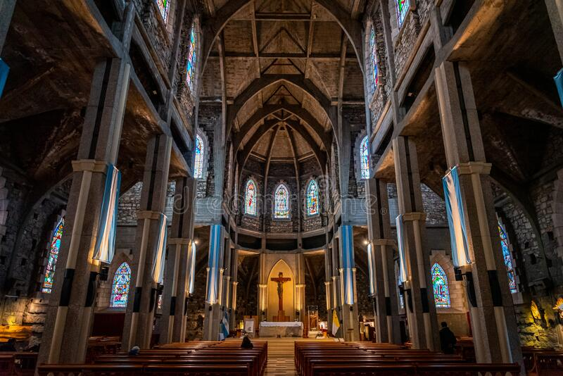 BARILOCHE, ARGENTINA, JUNE 18, 2019: Interior of Nuestra Senora del Nahuel Huapi Cathedral. Decorated with lots of argentinian. Flags stock photography