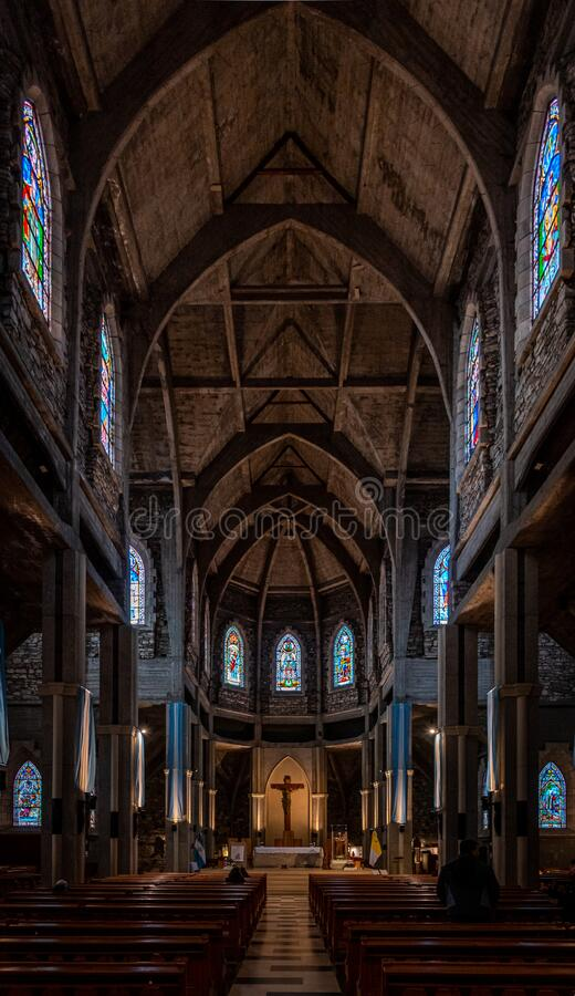 BARILOCHE, ARGENTINA, JUNE 18, 2019: Interior of Nuestra Senora del Nahuel Huapi Cathedral. Decorated with lots of. Argentinian flags royalty free stock images
