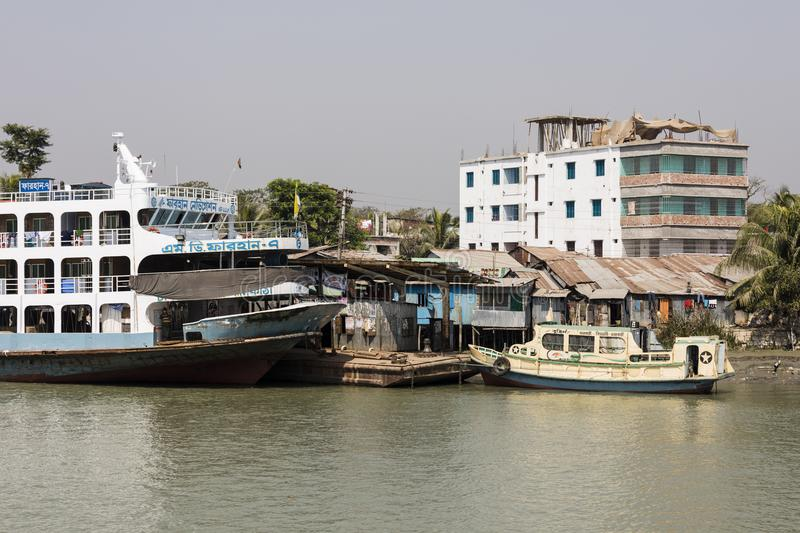 Barisal, Bangladesh, February 27 2017: Barisal terminal with a ferry. Barisal, Bangladesh, February 27 2017: Barisal terminal with a modern passenger ship docked royalty free stock photos