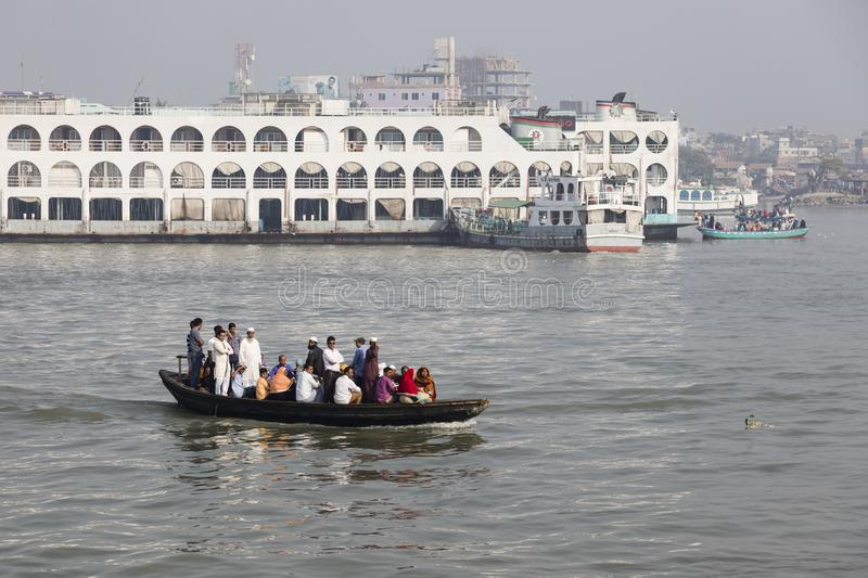Barisal, Bangladesh, February 27 2017: Crowded water taxi transits in the port. Of Barisal in front of a passenger ferry stock image