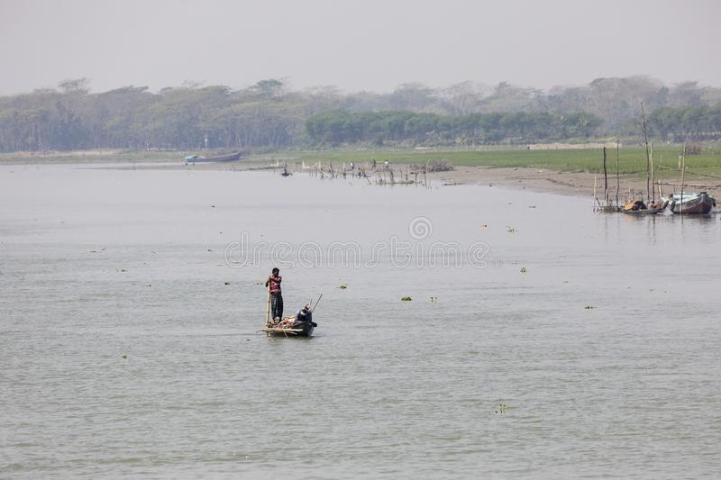 Barisal, Bangladesh, February 27 2017: Tropical river landscape. With a fishing boat in Bangladesh royalty free stock photos