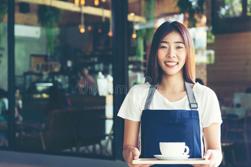 Barista asian women Cafe Making Coffee Preparation. stock images