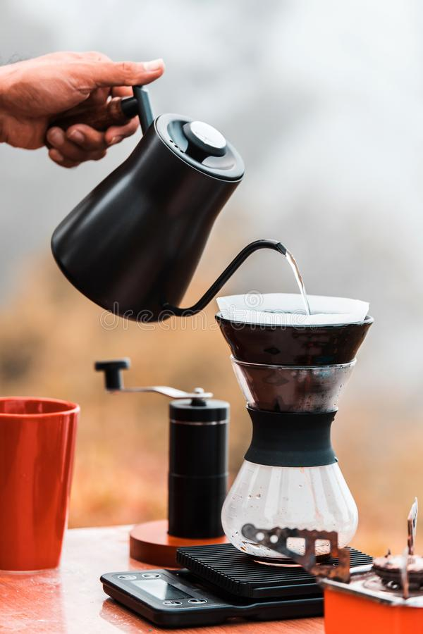 Barista brewing coffee, method pour over, drip coffee stock images