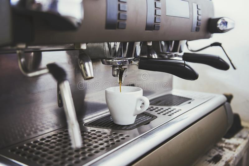 Barista. Close-up of an espresso machine making a cup of coffee stock photos