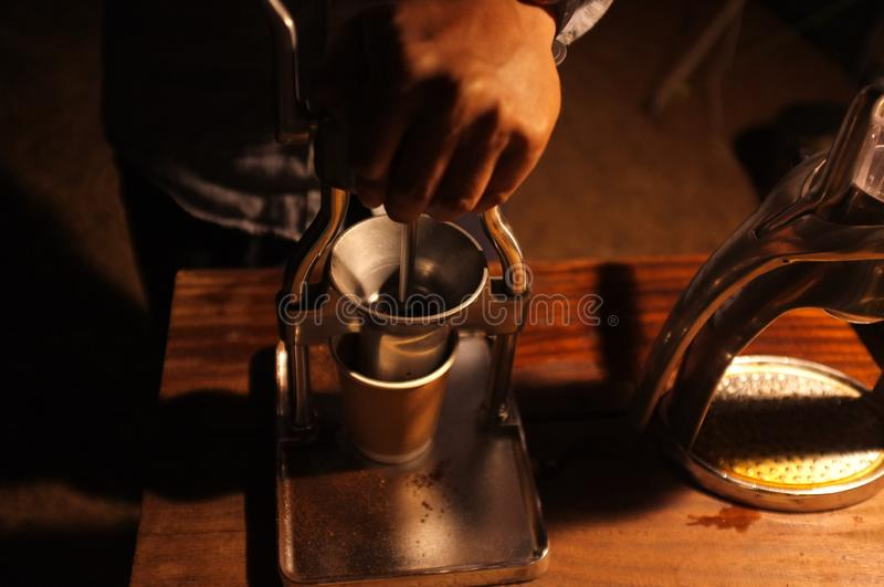 Barista grinding coffee beans, Manual coffee grinder royalty free stock image