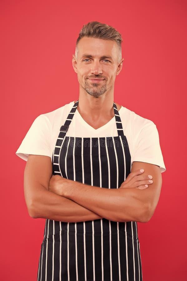 Barista handsome worker. Man cook wear apron. Fast food restaurant. Mature barista. Restaurant staff. Hipster. Professional barista apron uniform. Waiter or stock photo