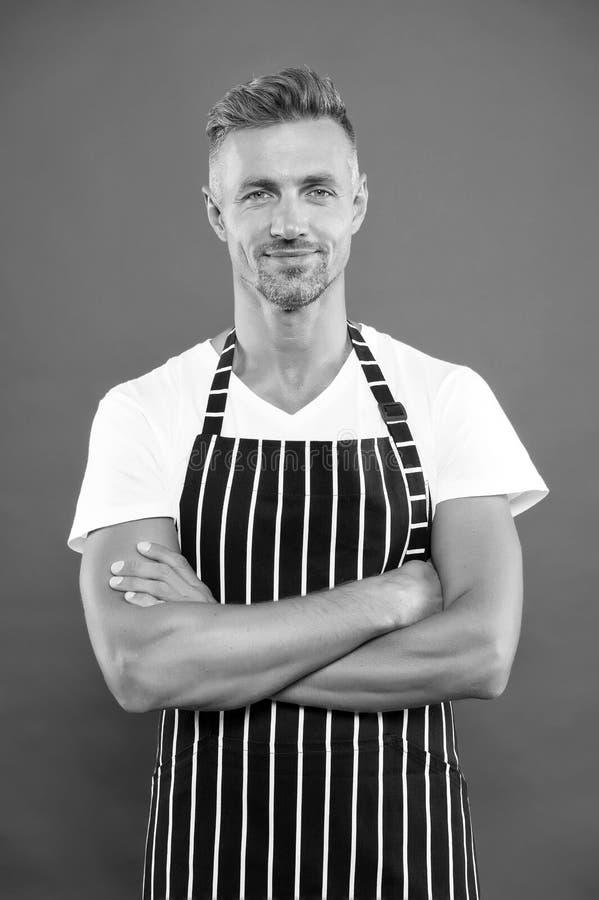 Barista handsome worker. Man cook wear apron. Fast food restaurant. Mature barista. Restaurant staff. Hipster. Professional barista apron uniform. Waiter or stock image