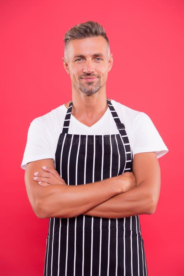 Barista handsome worker. Man cook wear apron. Fast food restaurant. Mature barista. Restaurant staff. Hipster. Professional barista apron uniform. Waiter or stock photography