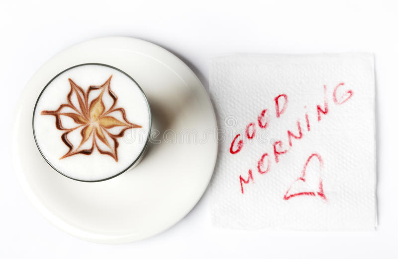 Barista latte coffee glass with good morning note. On tissue stock images