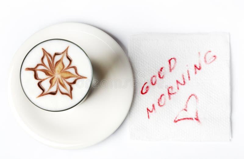 Barista latte Kaffeeglas mit Anmerkung des guten Morgens lizenzfreie stockbilder