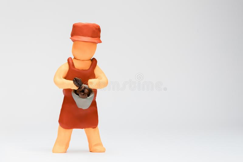 Barista made from plasticine on white background, aligned to the left stock image