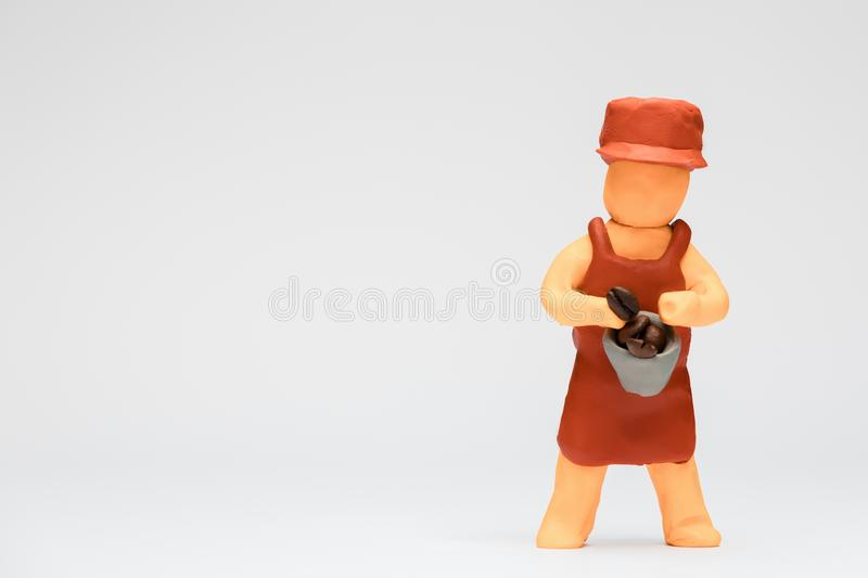 Barista made from plasticine on white background, aligned to the right royalty free stock photo