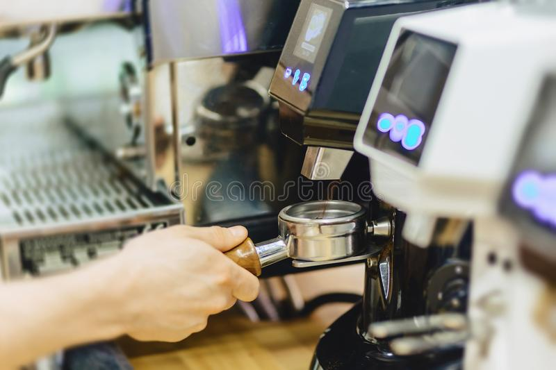 barista makes coffee closup royalty free stock images