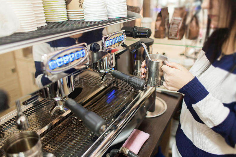 Barista Making coffee or cocoa in bar royalty free stock photos