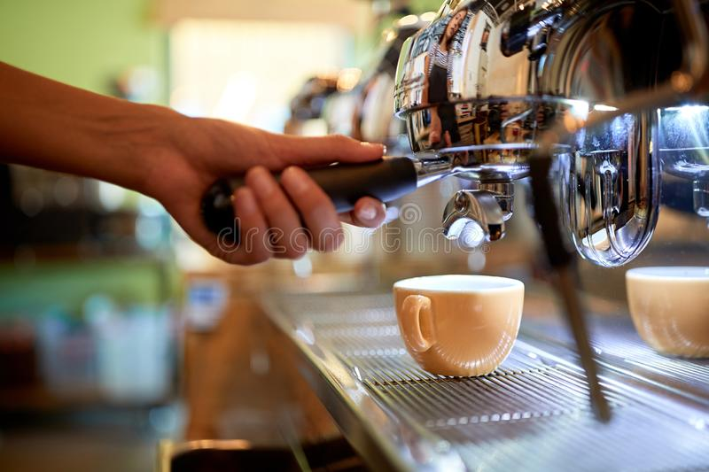 Barista making coffee on coffee maker machine royalty free stock images