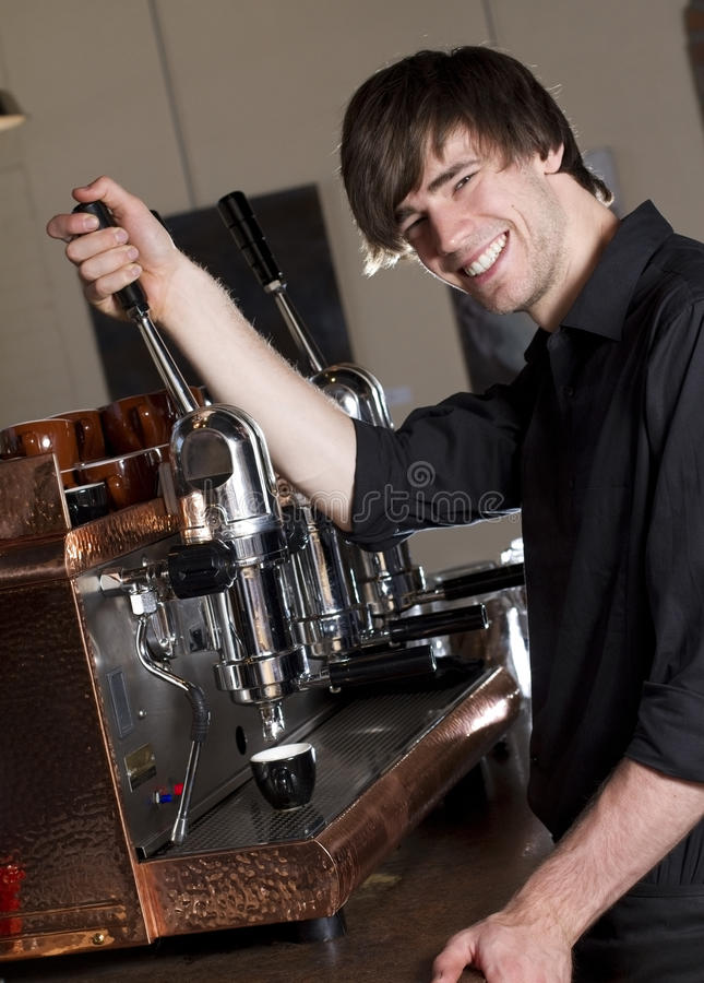 Barista making an espresso royalty free stock photo