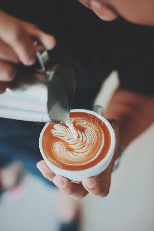 Barista making latte art royalty free stock photography