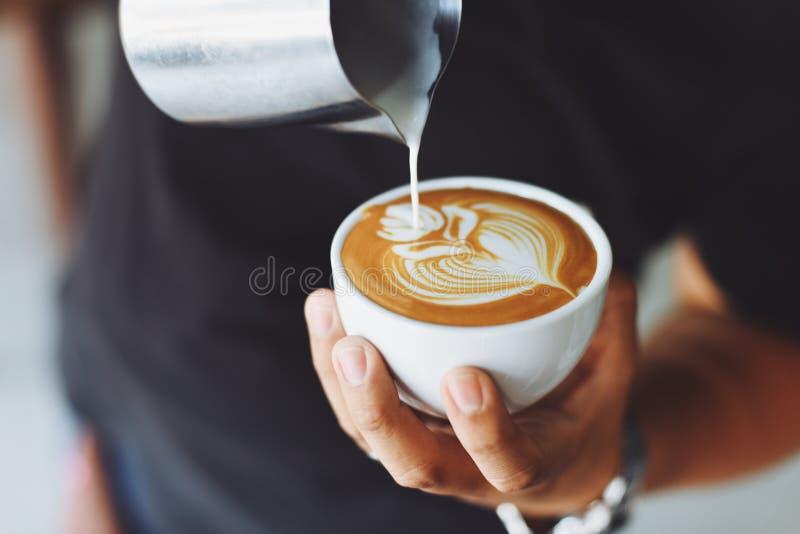 Barista making latte art stock images