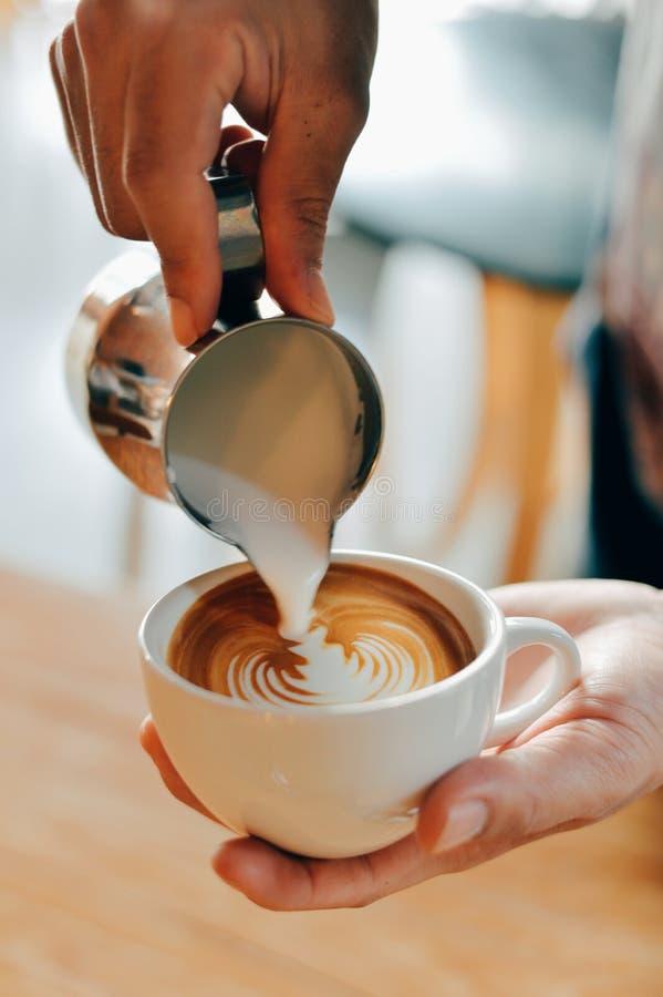 Barista making latte art stock photography