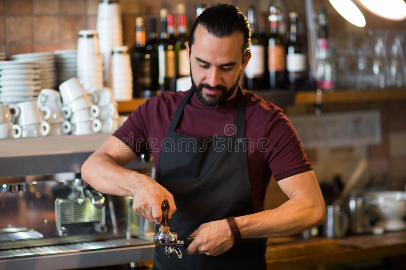 Barista man making espresso at bar or coffee shop stock images
