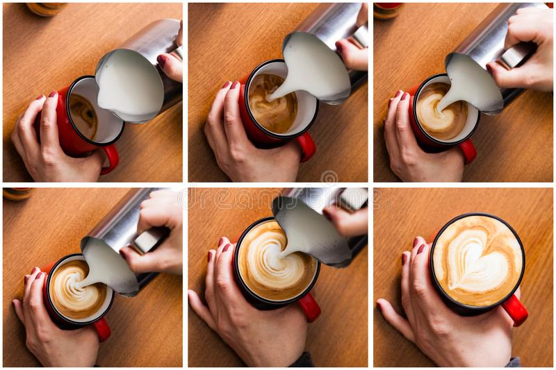 Barista pouring milk in coffee royalty free stock image