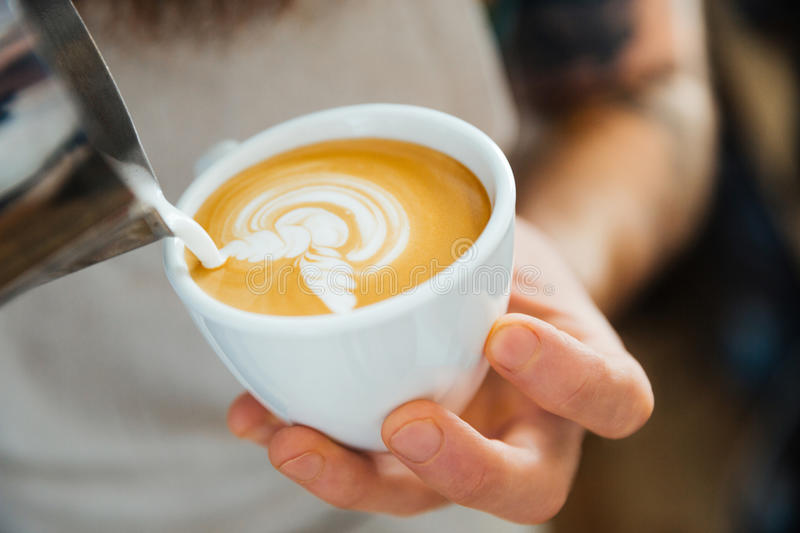 Barista Pouring Milk Into Cup Of Coffee Stock Photo ...
