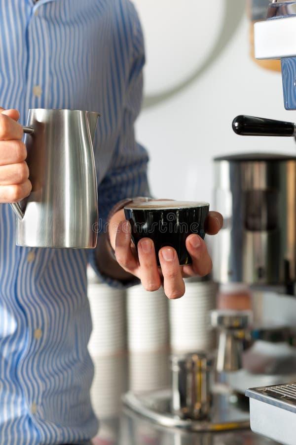 Barista prepares cappuccino royalty free stock photos