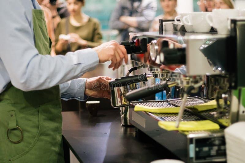 Barista prepares cappuccino latte espresso service coffeeshop stock photo