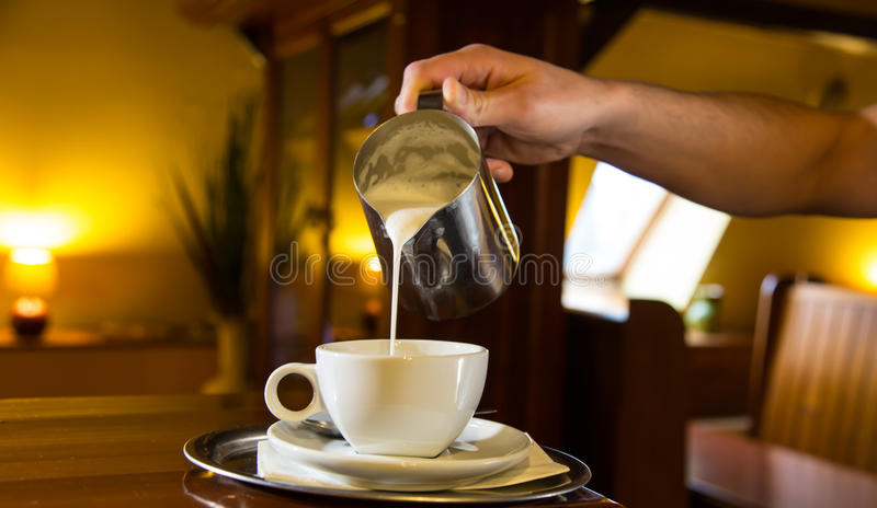 Barista prepares coffee at the coffee shop royalty free stock photo