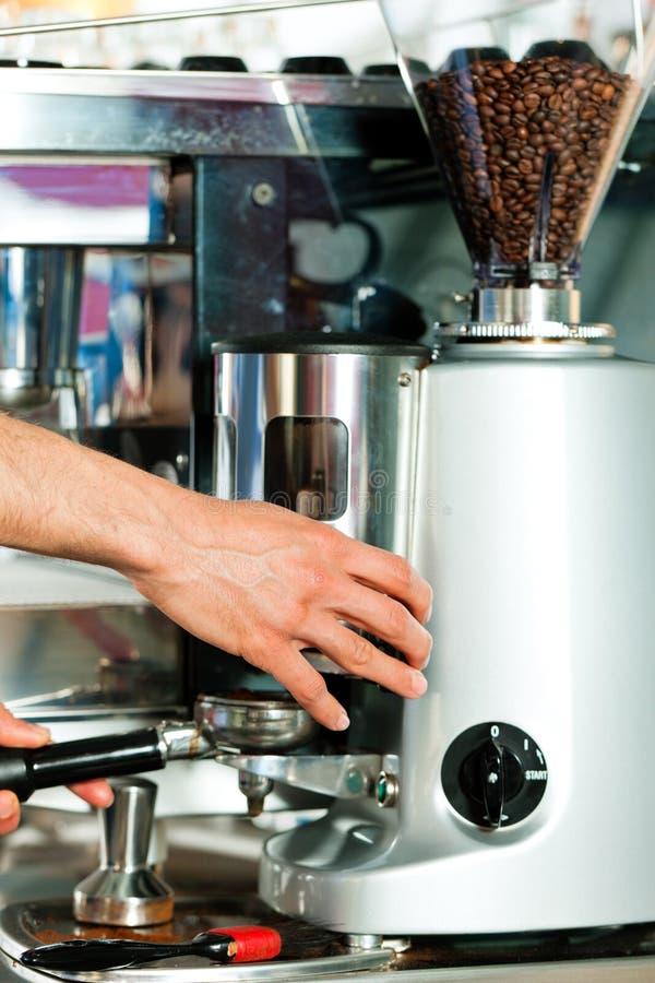 Barista prepares espresso stock images