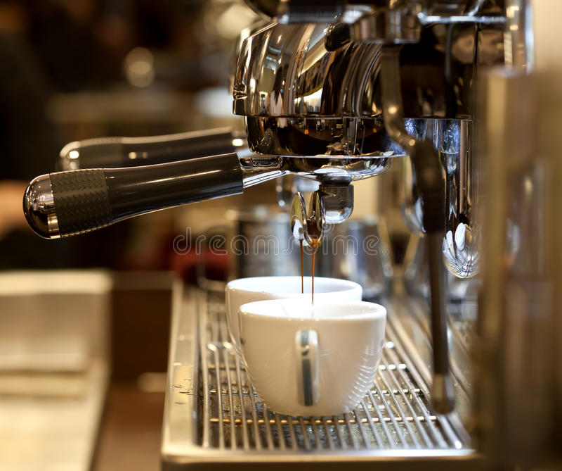 Barista prepares espresso stock photo
