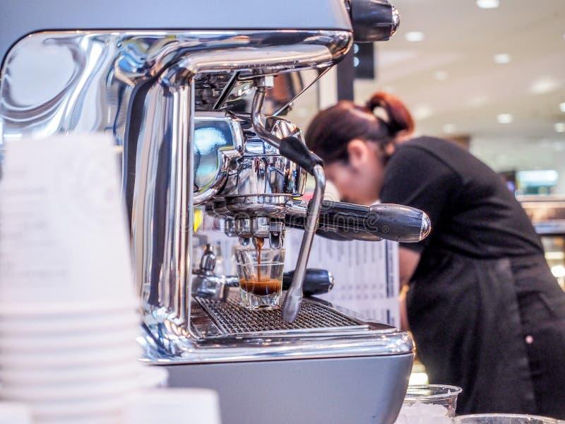 Barista prepares latte royalty free stock photo