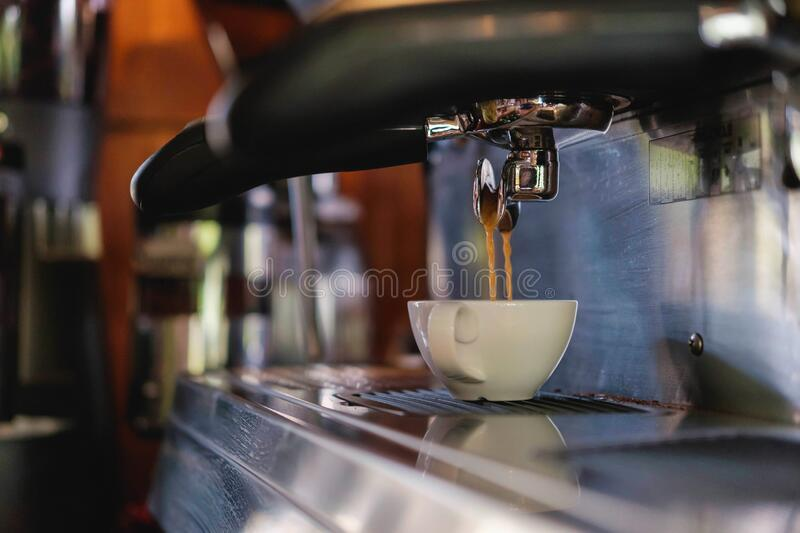 Barista prepares to make coffee with a coffee machine.  stock photography