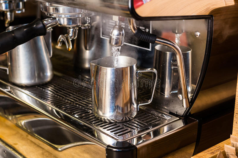 Barista preparing hot water for takeaway coffee. Barista coffee preparation service concept royalty free stock photo