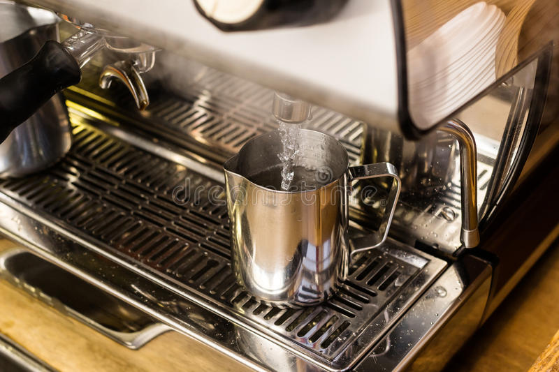 Barista preparing hot water for takeaway coffee. Barista coffee preparation service concept royalty free stock images
