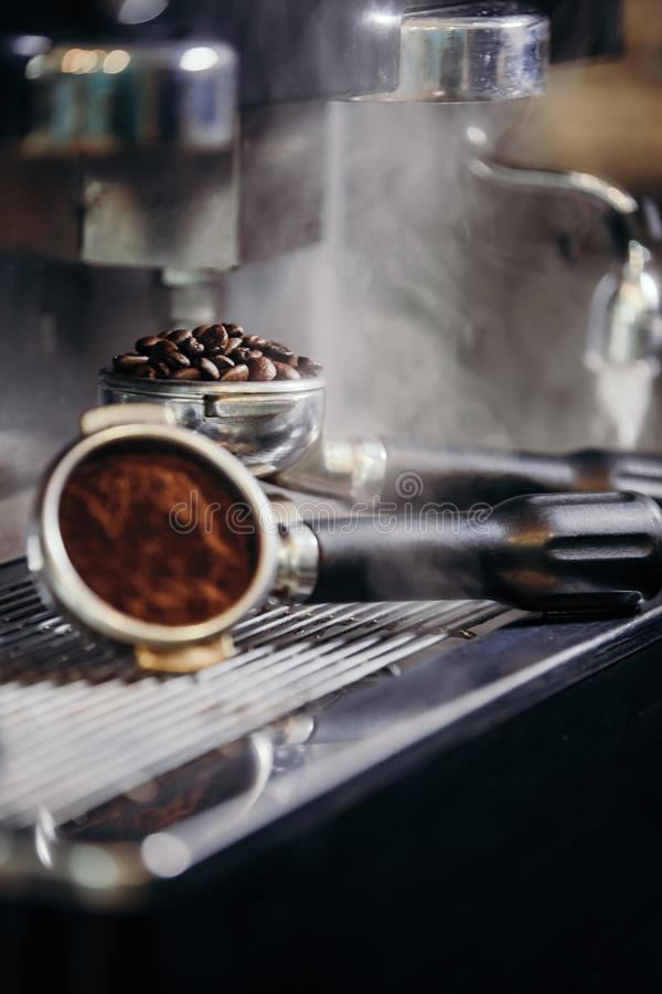 Barista roasting coffee beans grinder on coffee espresso machine stock image