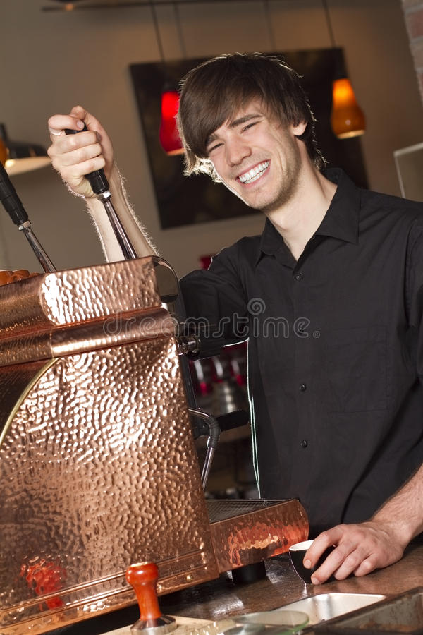 Barista Smiles at Work royalty free stock photo