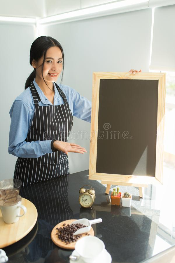 Barista suggest beverages on menu board royalty free stock image