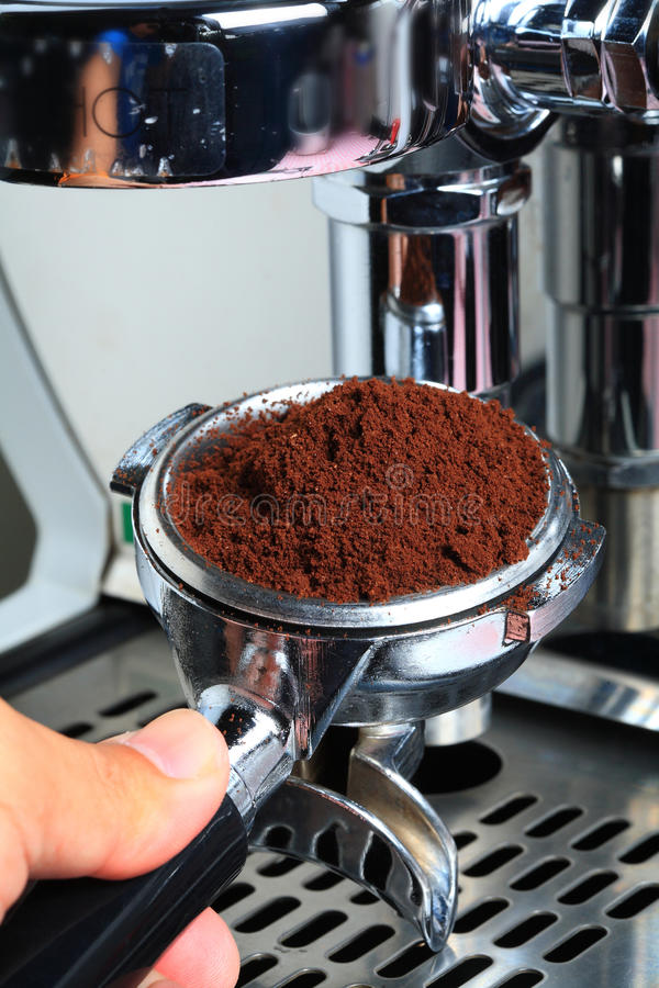Barista take coffee grind to making Espresso royalty free stock image