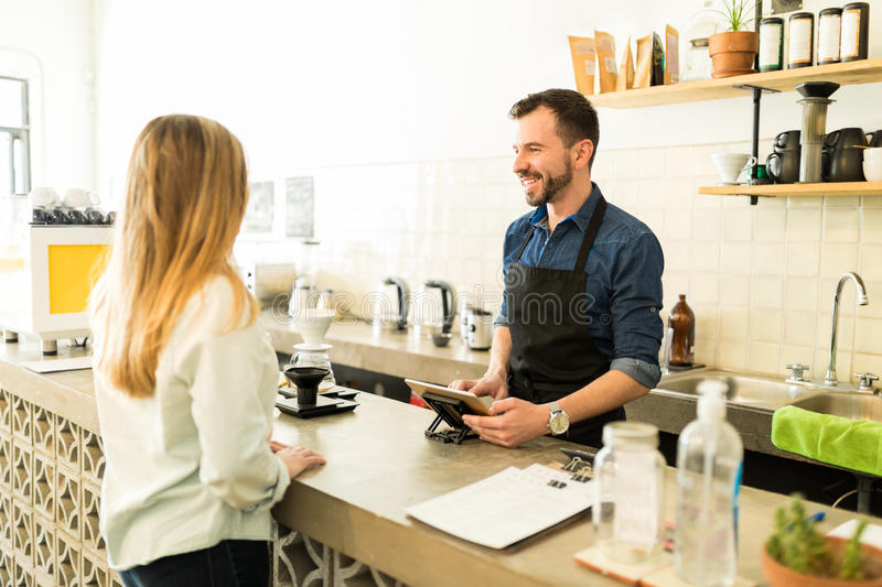 Barista taking order with a tablet stock images