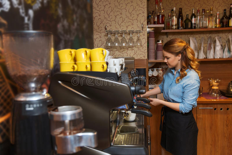 Barista woman making coffee by machine at cafe royalty free stock photos