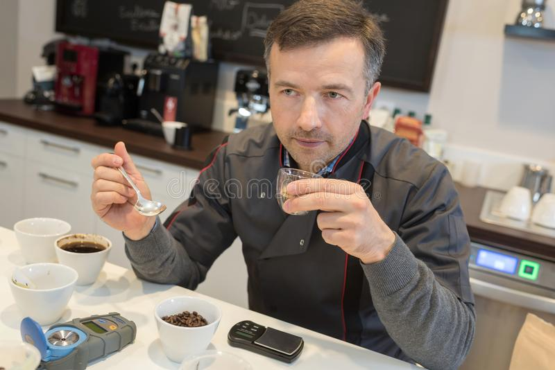 Baristas training to make perfect cup coffee stock photos