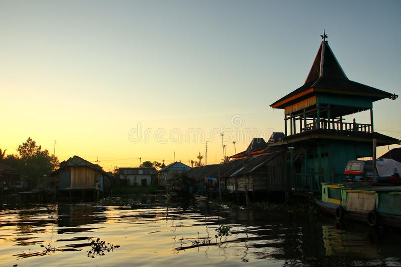 Barito river floating market in the morning. Citra Bahari Barito river floating market in the morning, full of gold from the sunrise in Banjarmasin / South royalty free stock images