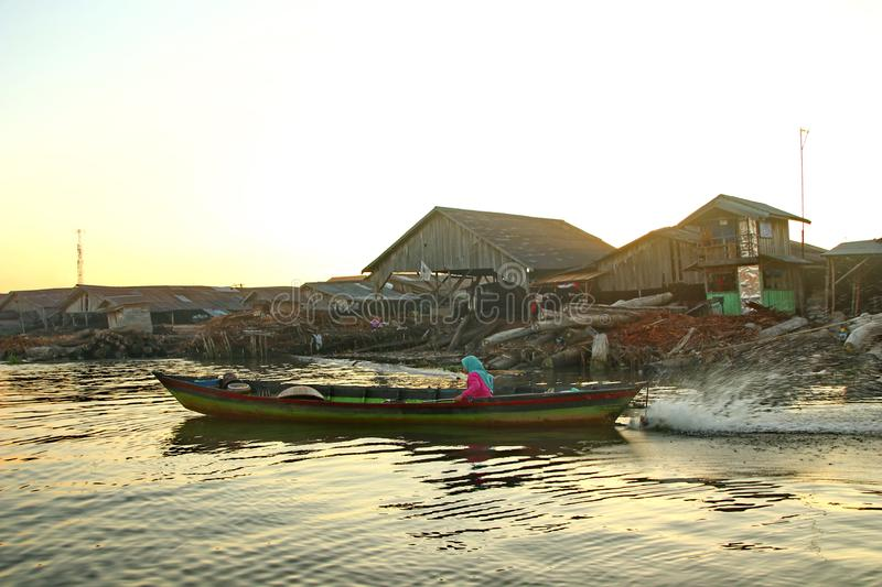 Barito river floating market in the morning. Citra Bahari Barito river floating market in the morning, full of gold from the sunrise in Banjarmasin / South stock photography